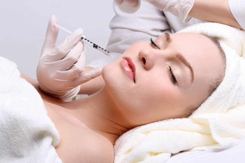Anti aging facial mesotherapy with syringe closeup on woman face